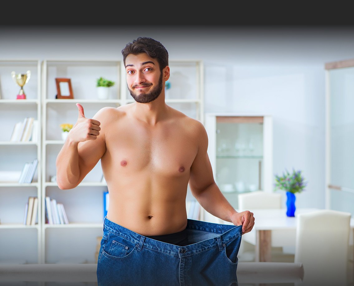 portrait of guy showing his lose of weight